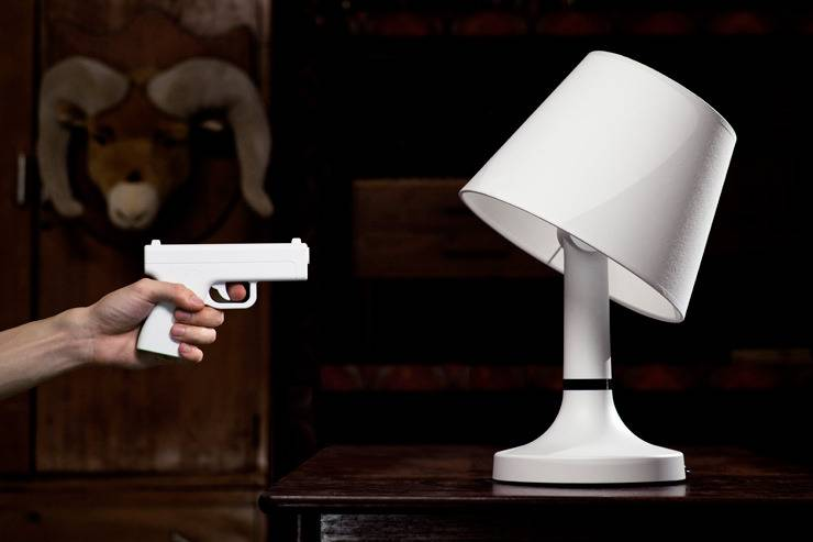 Cool Office Gadgets Part - 22: What About Lighting Up Your Office With A Bang. Take The Gun-shaped Remote  And Shoot That Lamp. It Will Turn Off, And Bend Sideways Playing Dead!
