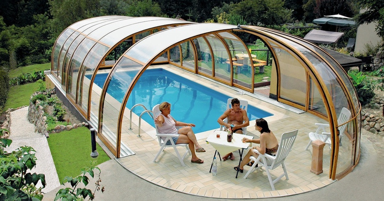 You Can Have An Outdoor And Indoor Pool With This Enclosure