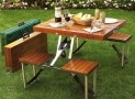 A Wooden Picnic Table That Folds Into A Carrying Case
