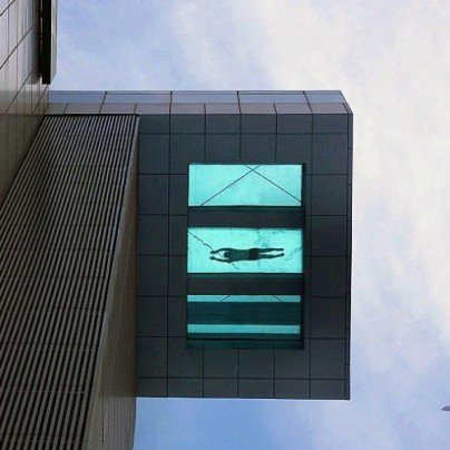 A 24th Story Glass-Bottom Swimming Pool